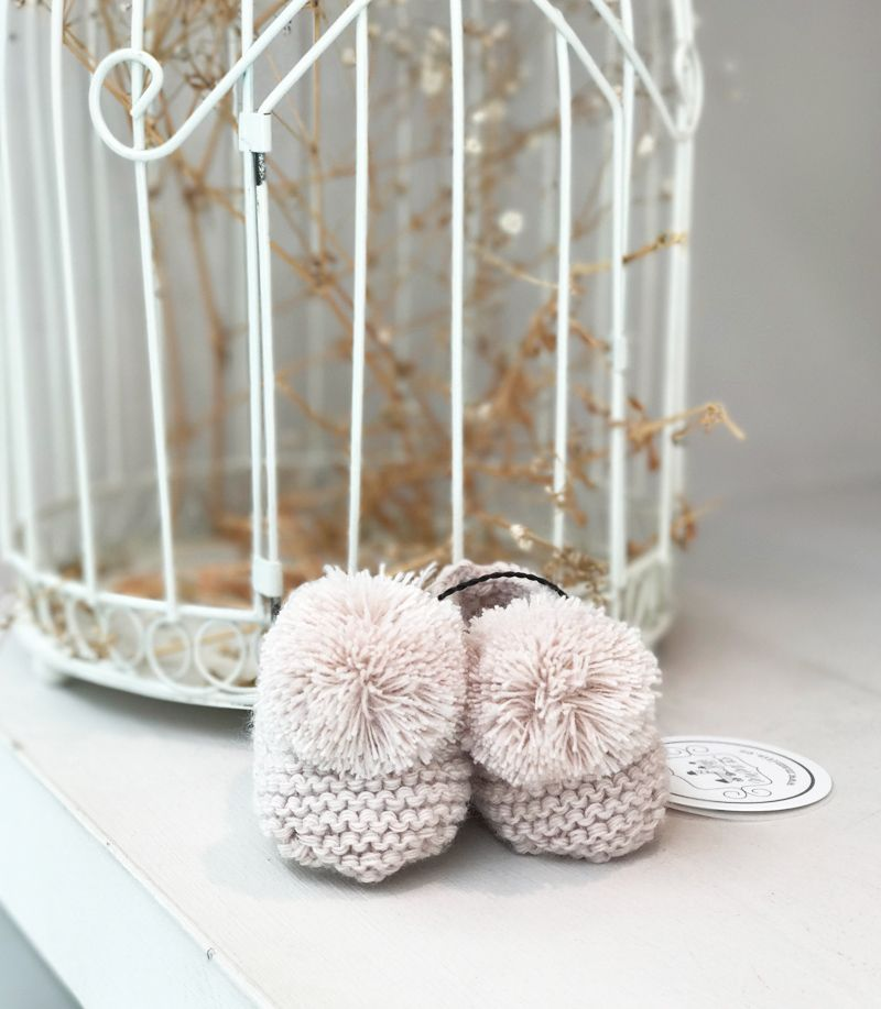 paticos rosas con pompones